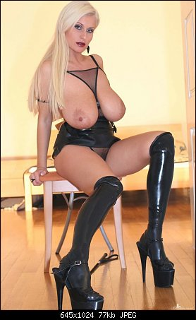 Busty Blonde Cassandra In Latex With Her Whip Celebsroulette 1